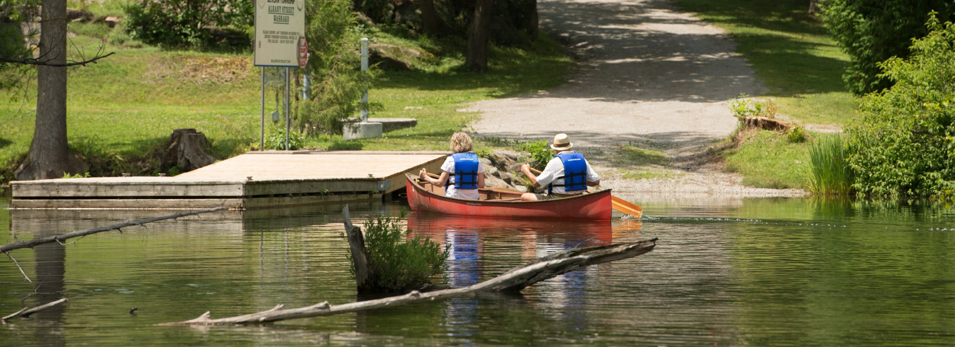 couple paddling near public dock